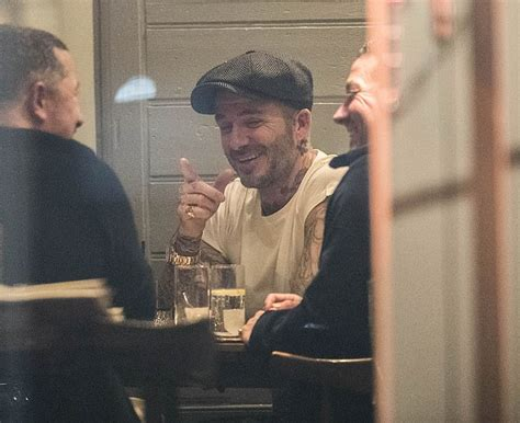 David Beckham gets the giggles as he treats himself to a