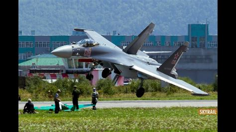 SU35 touch runway by wing on hard landing - YouTube