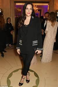 Liv Tyler plays doting mother on family shopping trip in